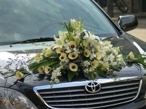Wedding Flowers taped onto the wedding car !