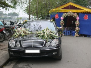 By Truc Bach Lake, Hanoi - stunning wedding car with flowers, marque ready for guests.