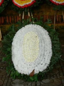 A white funeral flower stand is dedicated only for children.