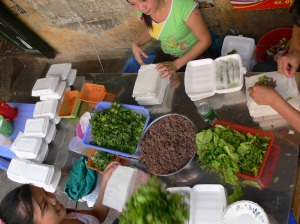 Phở Cuốn / Pho Cuon or Beef Salad Rolls are getting made and are a specialty of the streets on Truc Bach Lake, Hanoi ( Nguyen Khac Hieu Street).