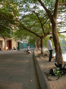 Bike getting fixed in middle of the road, lucky not much traffic around Truc Bach Lake.