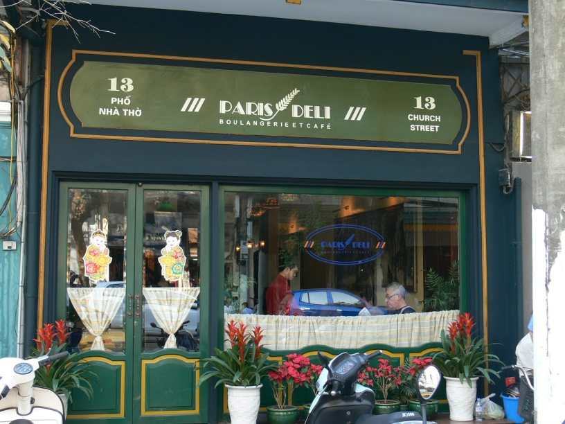 Paris Deli - sit by the window (unless I am there) and watch the world go by on Pho Nha Tho or 13 Church Street, Hanoi.