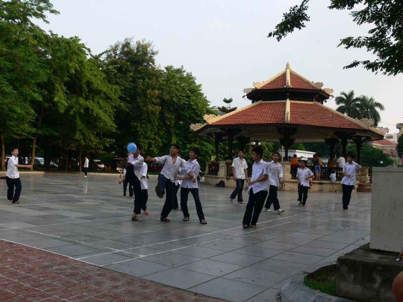 Game of soccer on tiled area in park behind Ly Thai To Statue, Hanoi.