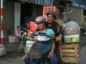 Happy chappy with his load of boxes of fruit, a lady and a bicycle - coming back from Long Bien Market. Good on ya !!