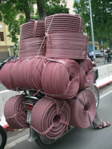 I am impressed, it looks so orderly, 16 reels of rope tied to a bike.