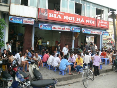 Bia Hoi Ha Noi - almost a drive in, just pull up a chair and enjoy the weather. and the locals