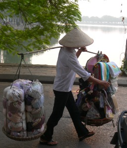 Feeling shy about your bra size ?? Discretely buy at home . . . now what else do I need? hair - bands, ties, clips; shoe liners, hand towels, face cloths, face masks, knickers (underwear) pr nail scissors ? Street Vendor around Truc Bach Lake, Hanoi.