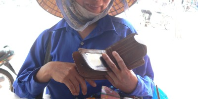 Street vendor says: And . . . oh yeah and I have this wallet on sale, just for today.