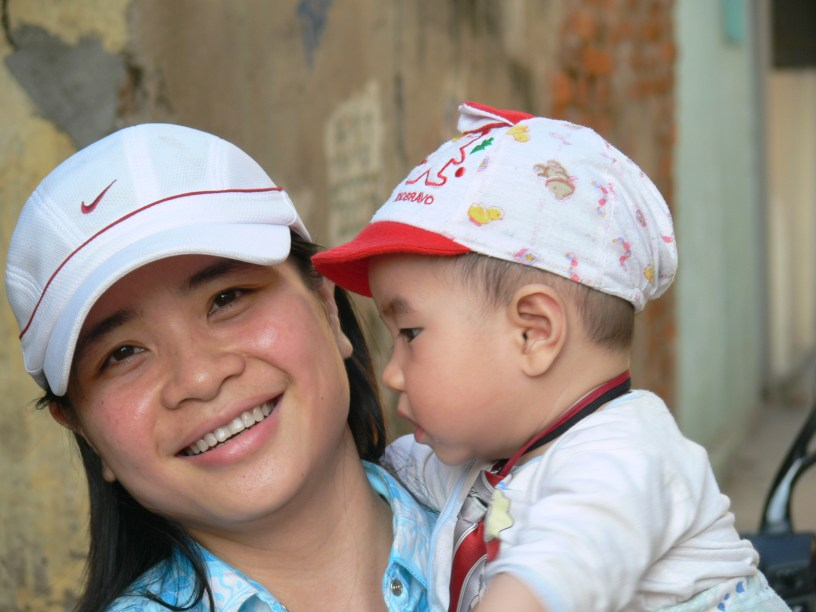 Vietnamese Mum holds her baby boy.