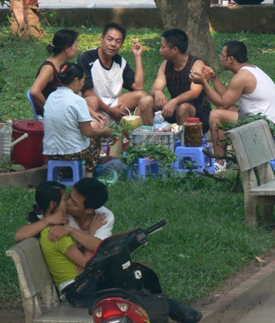 Public Kissing, young couple get into their kiss and other people sitting having tea, just ignore it.
