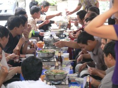 Boys Club (or company group) on an outing of steamboat lunch n the back streets of Truc Bach Lake. Normally that was a car park, then small tables and chairs set up for lunch time event.