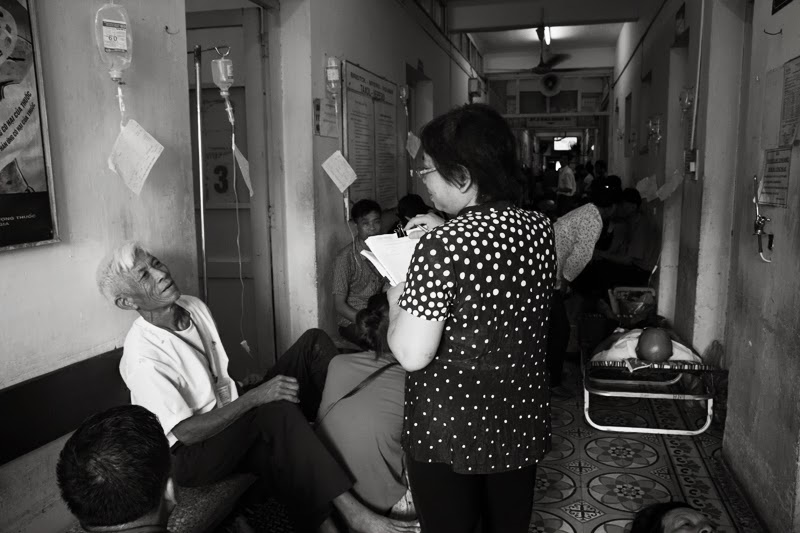 'Are you a poor patient' ? Seems a strange question. but poor patients that are officially classified this by the state are given priority. Taken by by Le Ngoc Anh.
