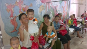 At the Children's Cancer Department, children hold gift bags from Sympameals to celebrate Mid Autumn Festival.