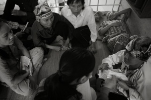 Sympameals talks to patients while giving out food coupons. By by Le Ngoc Anh.