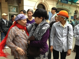 "Hanoi International Women's Club (HIWC) - donated scarves to these ladies ""Let me put it on for you'."