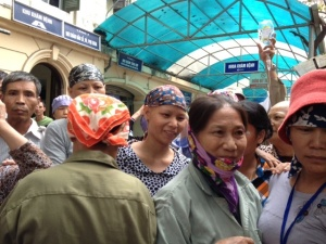 Ladies wait their turn to be given scarves from the Hanoi International Women's Club (HIWC) of Hanoi.